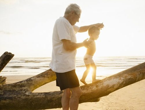 grandfather walking a child